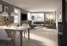 Lys og luftig åpen stue / kjøkkenløsning med store vindusflater og utgang til takterrassen.