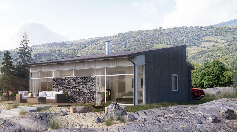 Tiltalende hytte med moderne uttrykk og store glassflater i Hurdalslia hyttegrend