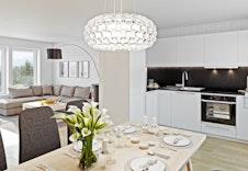 Illustrasjon av kjøkken og stue i  hus 5 og 6