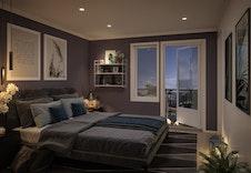Mørke toner på soverommet gir ett avslappende inntrykk.