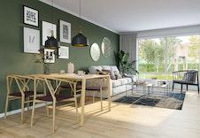 Åpen stue/kjøkkenløsning  i 1-roms leiligheten med utg. til egen uteplass.