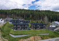 Leilighetene skal føye seg pent inn i det naturlige miljøet i Bergermarka.