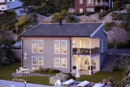 Fleksibelt, stort og moderne familiehus.  Sentralt plassert på en av Kvennstøa`s fineste tomter.