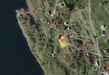 Oversiktsbilde - Tomten er markert med gul. Tomtestørrelse 768 m2.