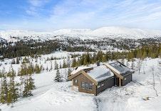 Ferdig oppført hytte på Tomt 3(Modell Bukkespranget). Hytta vil kunne sees på visning  7/3 12-14